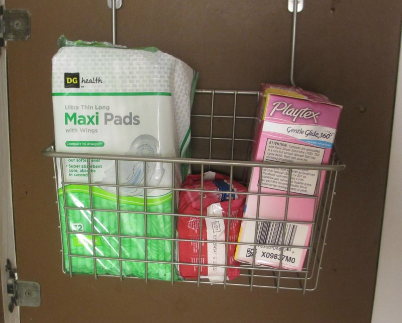 small bathroom storage solution over cabinet basket