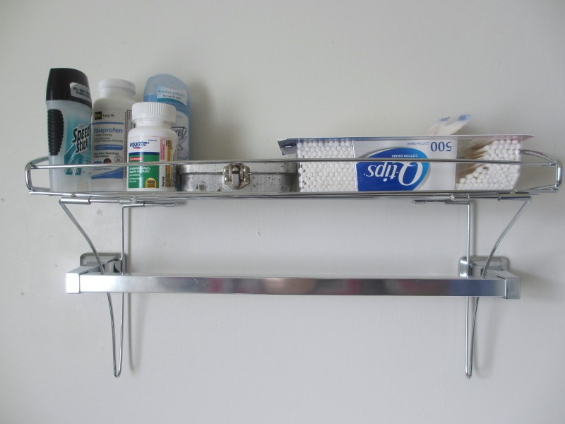 Small bathroom storage solution towel bar shelf