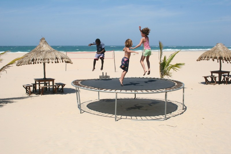 kids at the beach on a trampoline - Make Earth Day Every Day (With Spin Master)